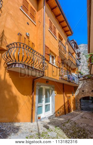 Entrance of an old apartment building in Limone, Garda, Italy.