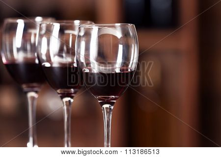 Glasses with red wine in cellar