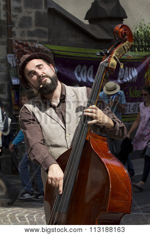 Musician playing double bass in the street.