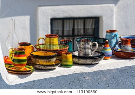 Traditional souvenirs of Oia town, Santorini island, Greece.