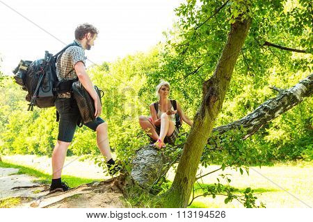 Hiking Young Couple With Backpack Outdoor