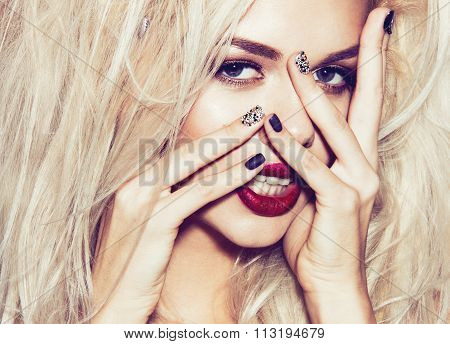 Beautiful sexy blonde girl with sensual lips, fashion hair, black art nails.Instagram filters. Beaut