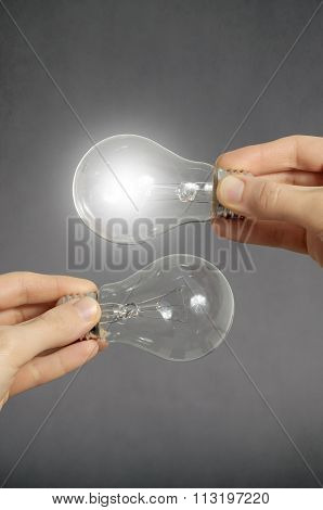 Decision Making Concept, Hands With Light Bulbs.