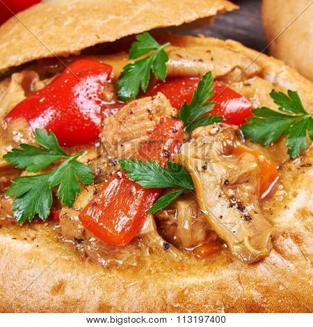 Stew Made From Meat, Vegetables And Mushrooms In A Bread Bowl