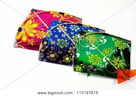 Colorful fighting kites isolated on white