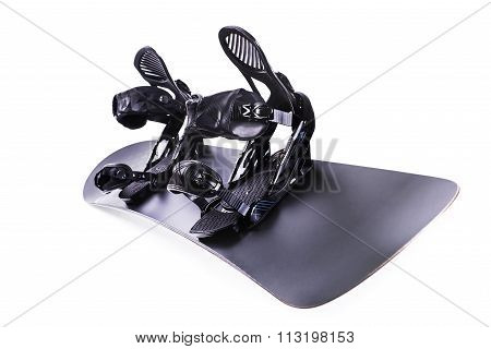 Black snowboard with black bindings isolated on white. With clipping path.