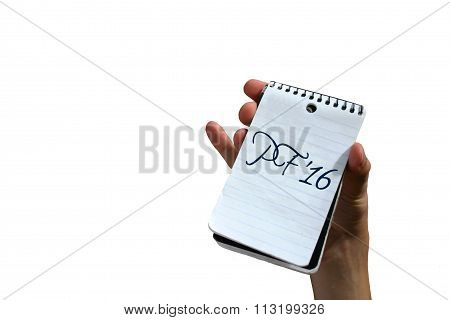 Hand holding notepad with Pour feliciter (PF) 2016