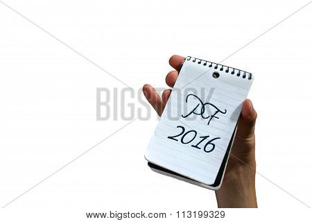 Hand holding notepad with PF 2016