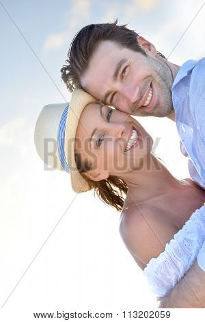 Portrait of cheerful couple on vacation in Caribbean island