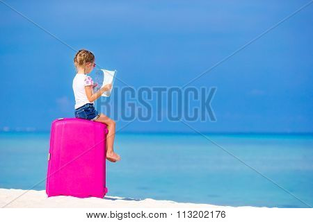 Adorable girl with big luggage and map of island on white beach