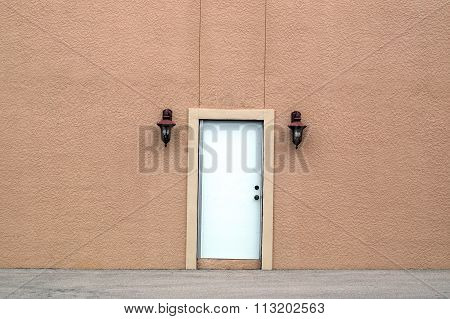 White Door In Large Wall