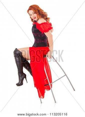 Elegant Retro Woman Wearing Red Gown and Boots on Chair