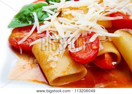 dish with paccheri and tomatoes sauce and basil