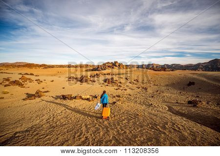 Traveler in the rocky desert