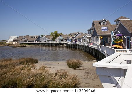 DUCK, NORTH CAROLINA - MAY 2, 2015: The Waterfront Shops in Duck offer a unique shopping experience over the water of the Currituck Sound in the Outer Banks of North Carolina.