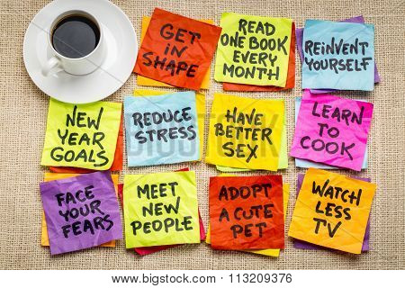 new year goals or resolutions - colorful sticky notes on canvas with coffee