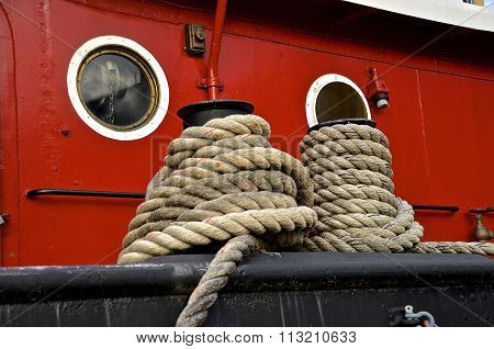 Mooring lines of a tug boat secure it to a quay