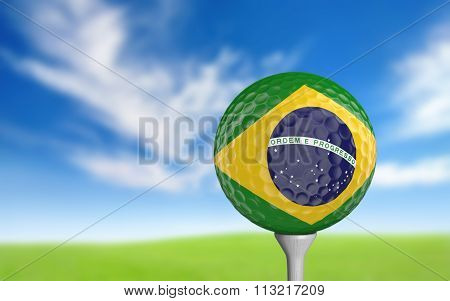 Golf ball with Brazil flag colors sitting on a tee