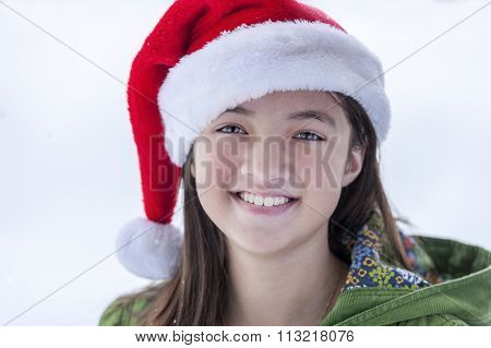 Happy Girl In Santa Hat.