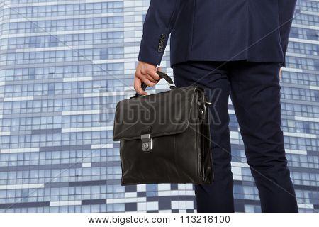 Portfolio investor. Businessman with briefcase