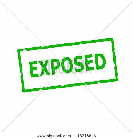 Exposed Green Stamp Text On Rectangular White Background