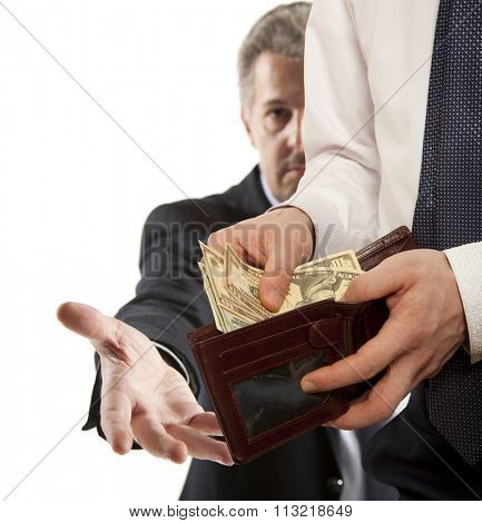 Businessman taking bribe over white background.  Business concept