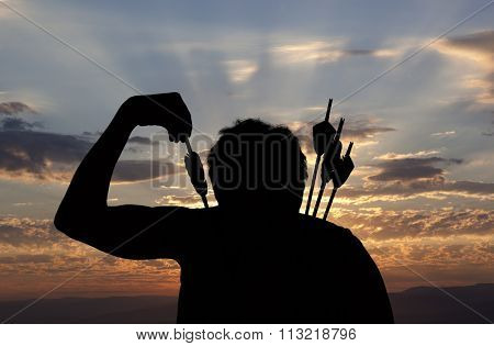 Silhouette of a witch-hunter of arrows. Fantasy concept