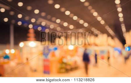 Blurred Image Of People At Trade Show With Vintage Tone