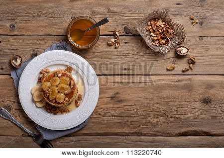Pancake With Nuts, Honey And Caramelized Bananas