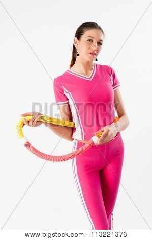 Young woman doing exercise with hula-hoop