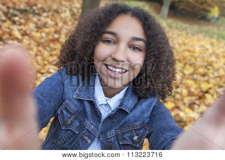 Beautiful happy mixed race African American girl teenager female child smiling with perfect teeth taking selfie photograph
