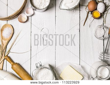 Baking Background. Ingredients For The Dough - Milk, Eggs, Flour, Sour Cream, Butter, Salt And Diffe