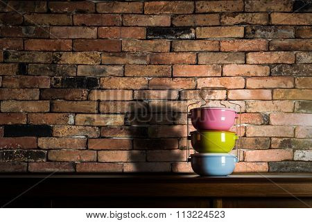 Colorful Tiffin Carrier On Wooden Cupboard