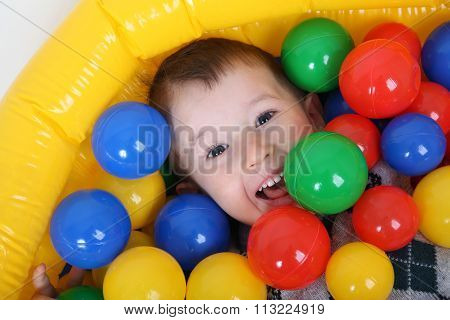 Little Smiling Boy Playing In Colorful Balls Playground