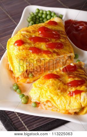 Japanese Omelet With Rice Omurice Close-up On A Plate. Vertical