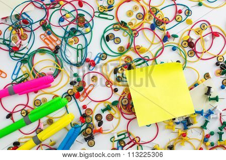 Colourful Paper Clips, Drawing Pins Thumb Tacks, Elastic Rubber Bands And Sticky Notes As A Texture