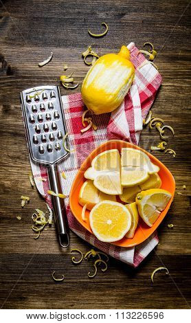 Fresh Lemons In The Bowl With The Zest And Grater On Fabric.