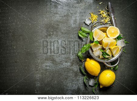 Fresh Lemons In A Saucepan With Leaves And Zest.