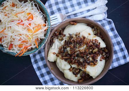 vareniki with bacon and coleslaw, top view