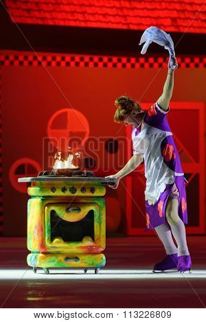 ST. PETERSBURG, RUSSIA - DECEMBER 29, 2015: Figure skater Alexey Tikhonov as Froken Bock in a scene of the New Year show Little Brother and Karlsson-on-the-Roof of Ilya Averbukh in the SC Yubileyniy