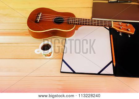 (vintage And Instagram Look) Of Classic Ukulele With Blank A4 Note