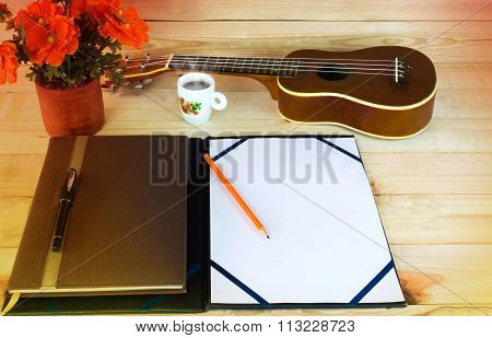 (vintage And Instagram Look) Blank A4 Note And Pencil On Wooden Table With Background Of Ukulele And