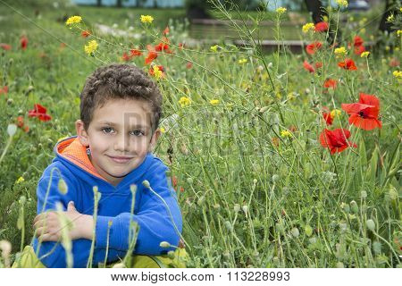 In Summer, The Park Is A Little Boy In A Flower Bed.