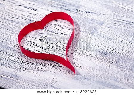 Red Ribbon Heart On Wooden Background