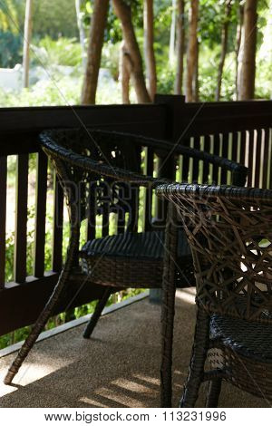 Black Rattan Chair On The Balcony