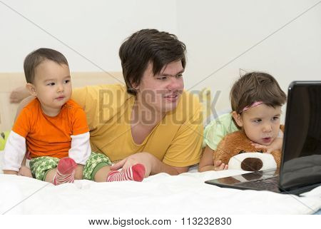 Big Brother Watching Cartoons With His Younger Sisters
