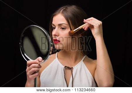 Woman With A Mirror And Makeup Brush
