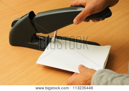 Binding Papers With Stapler By Both Hands
