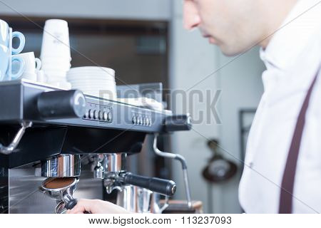 Bartender Puts The Holder In Coffee Machine