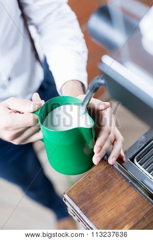 Close-up Of Man Hands Holding Pitcher With Milk